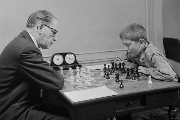 Childhood picture of Bobby Fischer playing chess