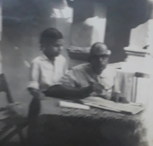 Childhood picture of H. C. Verma with his father