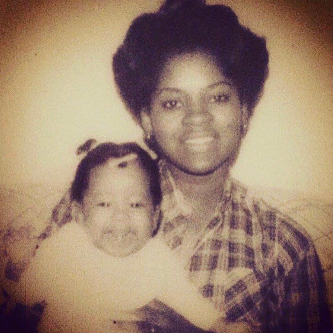 Childhood picture of Phoebe Robinson with her mother
