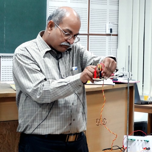 H. C. Verma giving a demonstration on a concept of Physics