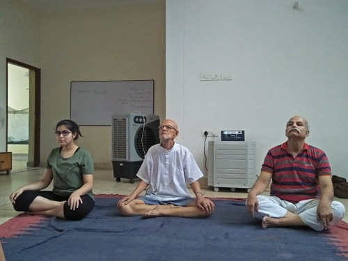 H. C. Verma (right) doing yoga with his brother and daughter