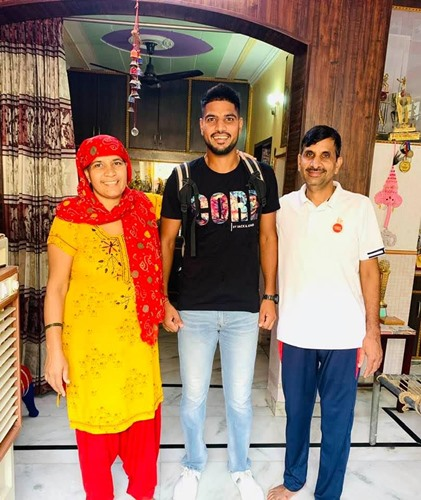 Lalit Yadav with his parents