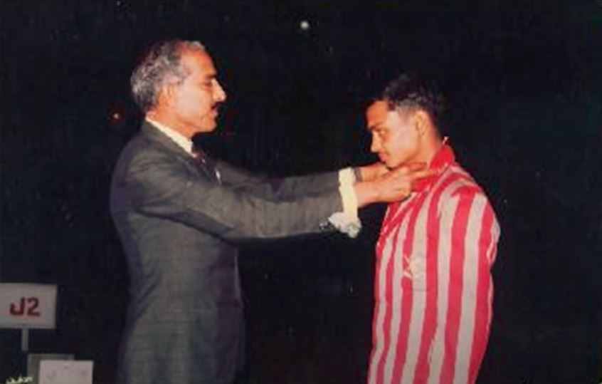 Sengar receiving gold medal in a platform diving competition held among the students of his NDA batch