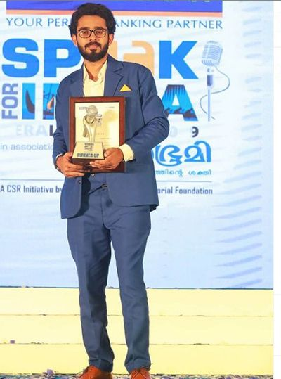 Adoney John with his award at Federal Bank Speak for India competition