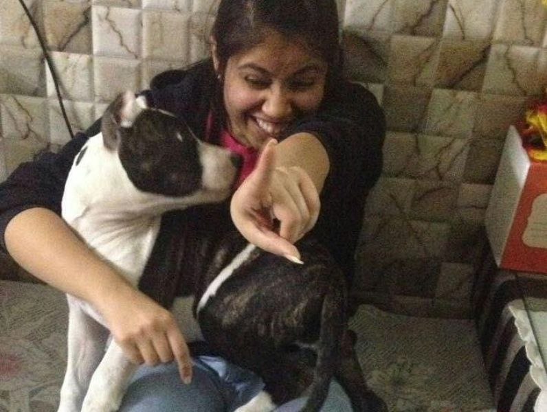 Akanksha Sharma playing with a dog