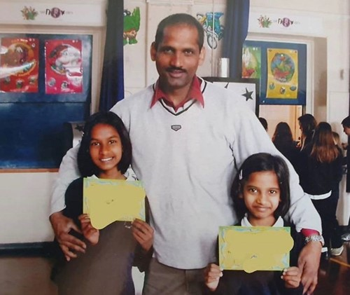 Amita Suman (right) with her father and elder sister