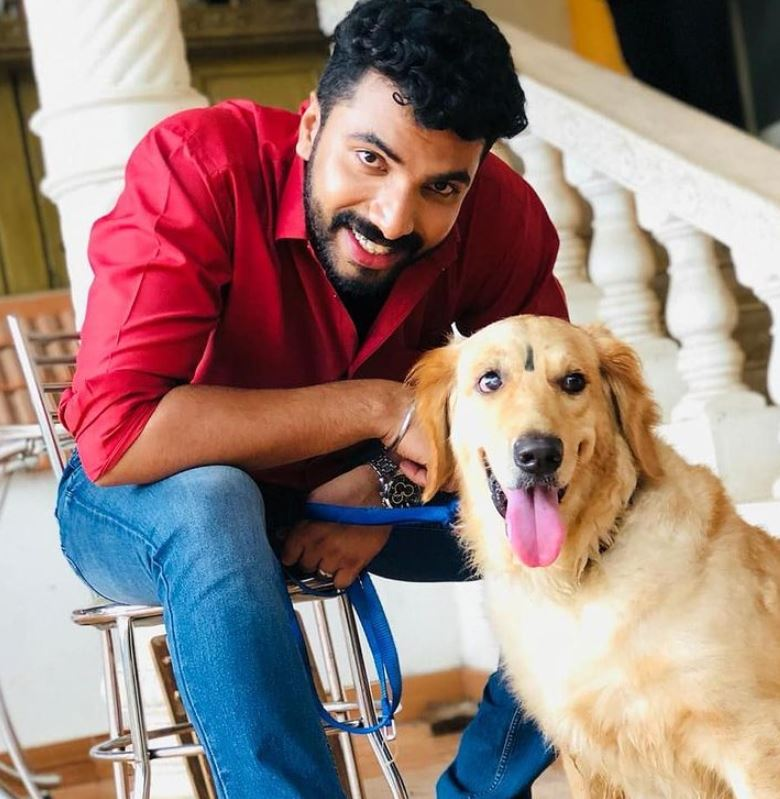 Anoop Krishnan with his pet dog