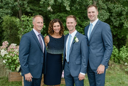 Calahan Skogman (right) with his parents and brother