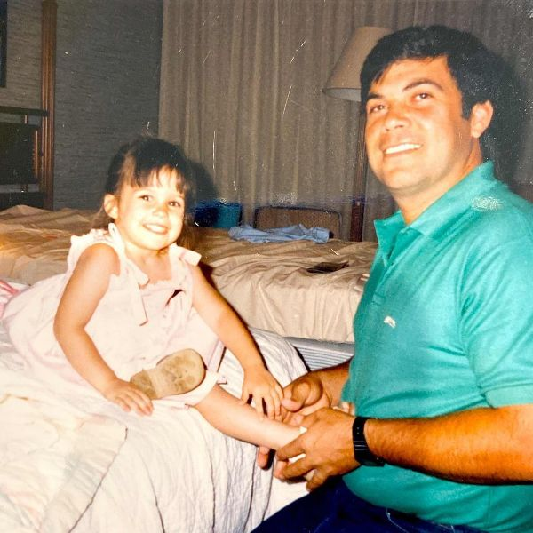 Childhood picture of Lacey Chabert with her father