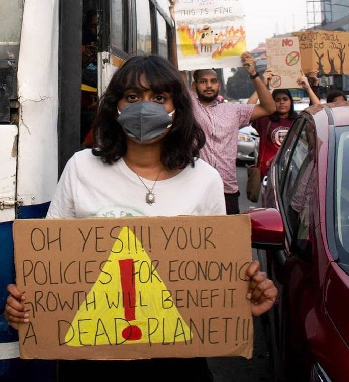 Disha Ravi displaying a placard warning about climate change during a protest held in Banglore