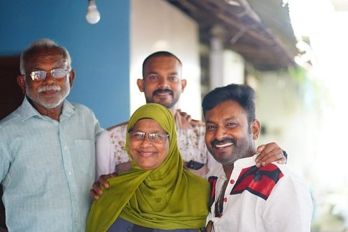 Firoz Azeez with his parents and brother