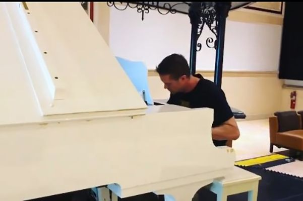 Garrent Dillahunt playing the piano