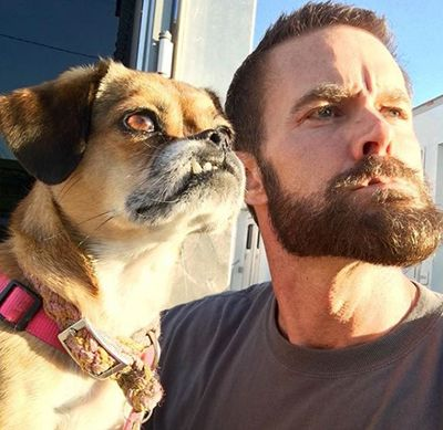 Garret Dillahunt posing with a dog