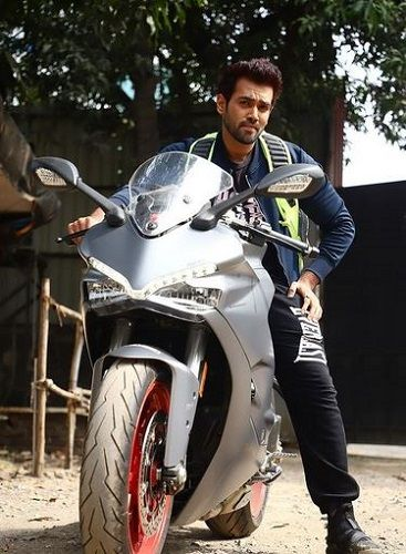 Karan Khanna posing with his Ducati motorcycle