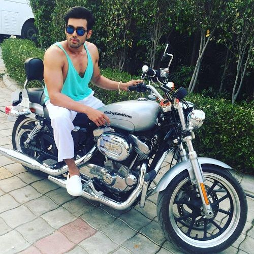 Karan Khanna sitting on his Harley Davidson motorcycle