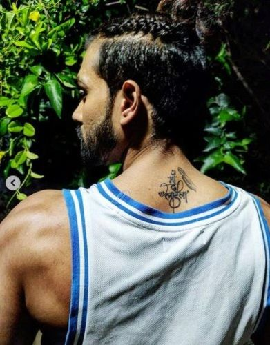 Karan Khanna's tattoo on back