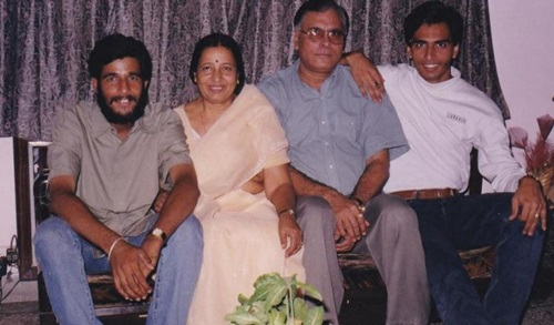 Major Mohit Sharma (left) with his parents and elder brother Madhur Sharma (right)