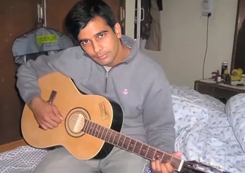 Major Mohit Sharma playing guitar