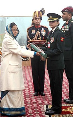 Major Mohit Sharma's wife, Major Rishima Sharma receiving the Ashoka Chakra award