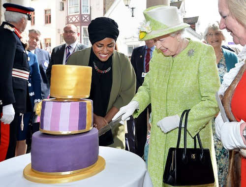 Queen Elizabeth 2 cutting the cake on her 90th birthday which was baked by Nadiya Hussain