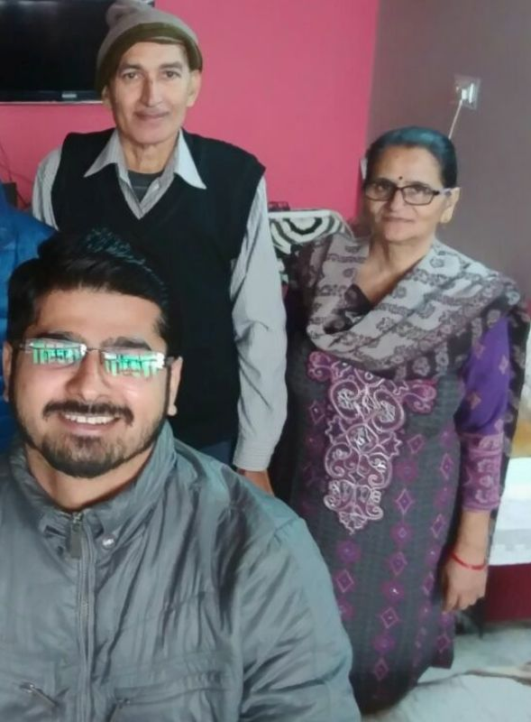 Rajat Chauhan with his parents