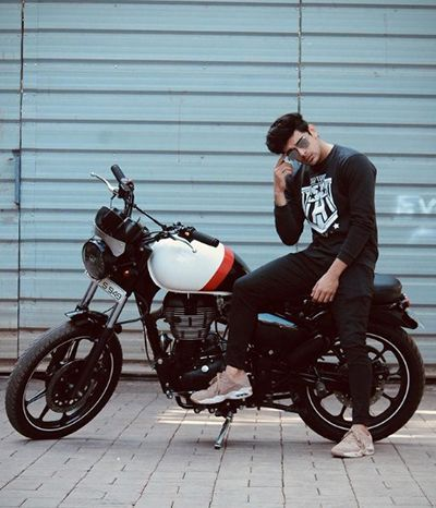 Ramzan Mohammed giving a pose with his bike