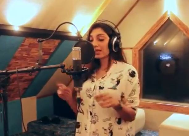 Rithu Manthra at a recording studio