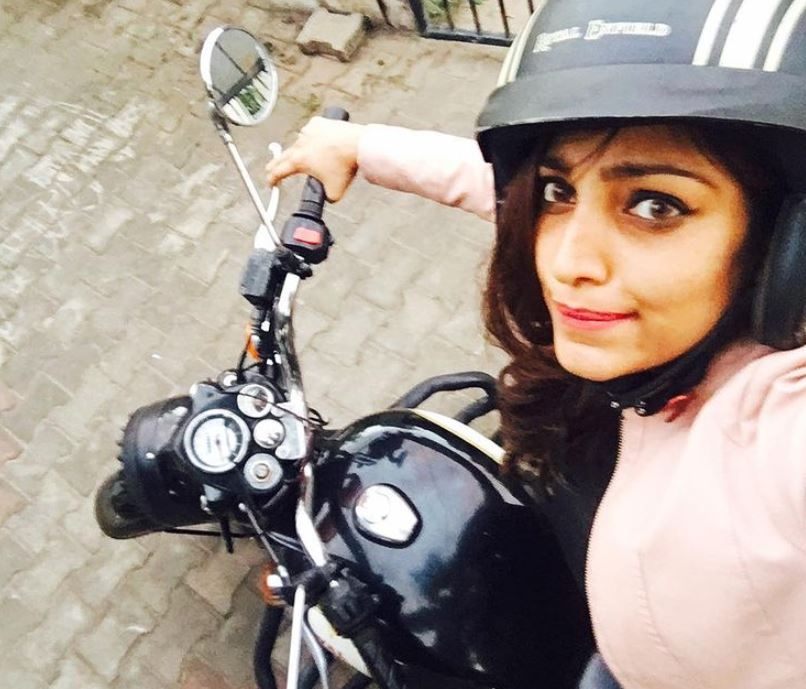 Rithu Manthra riding a bike