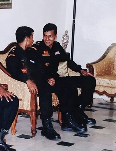 Sandeep Unnikrishnan laughing during conversation with his colleague