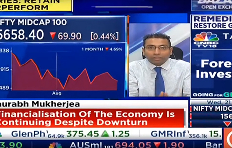 Saurabh Mukherjea discussing stocks on a news channel