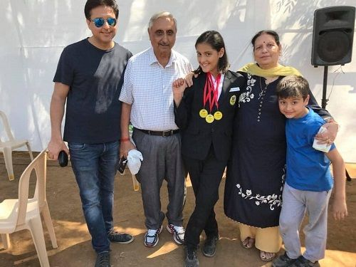 Sheehan Kapahi with his father, sister, and grandparents