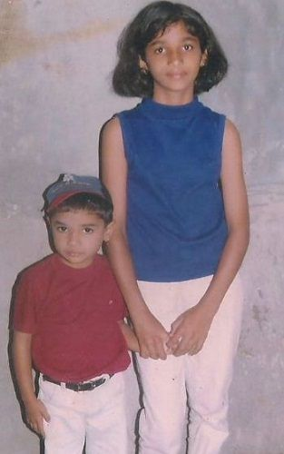 A childhood picture of Divya Suresh and her brother
