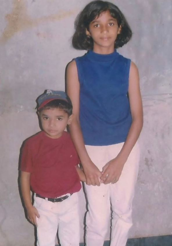 A childhood picture of Divya Uruduga with her younger sibling