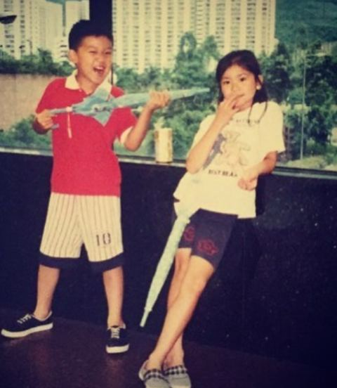 A childhood picture of Katie Leung with her brother