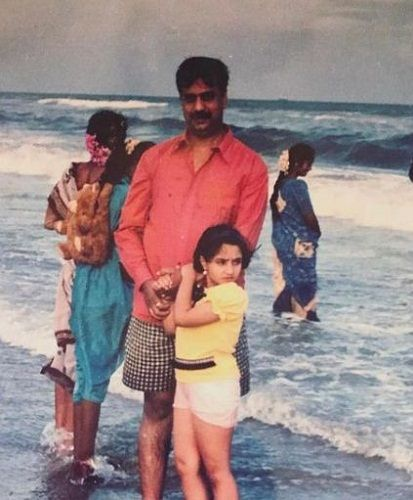 A childhood picture of Vaishnavi Gowda with her father