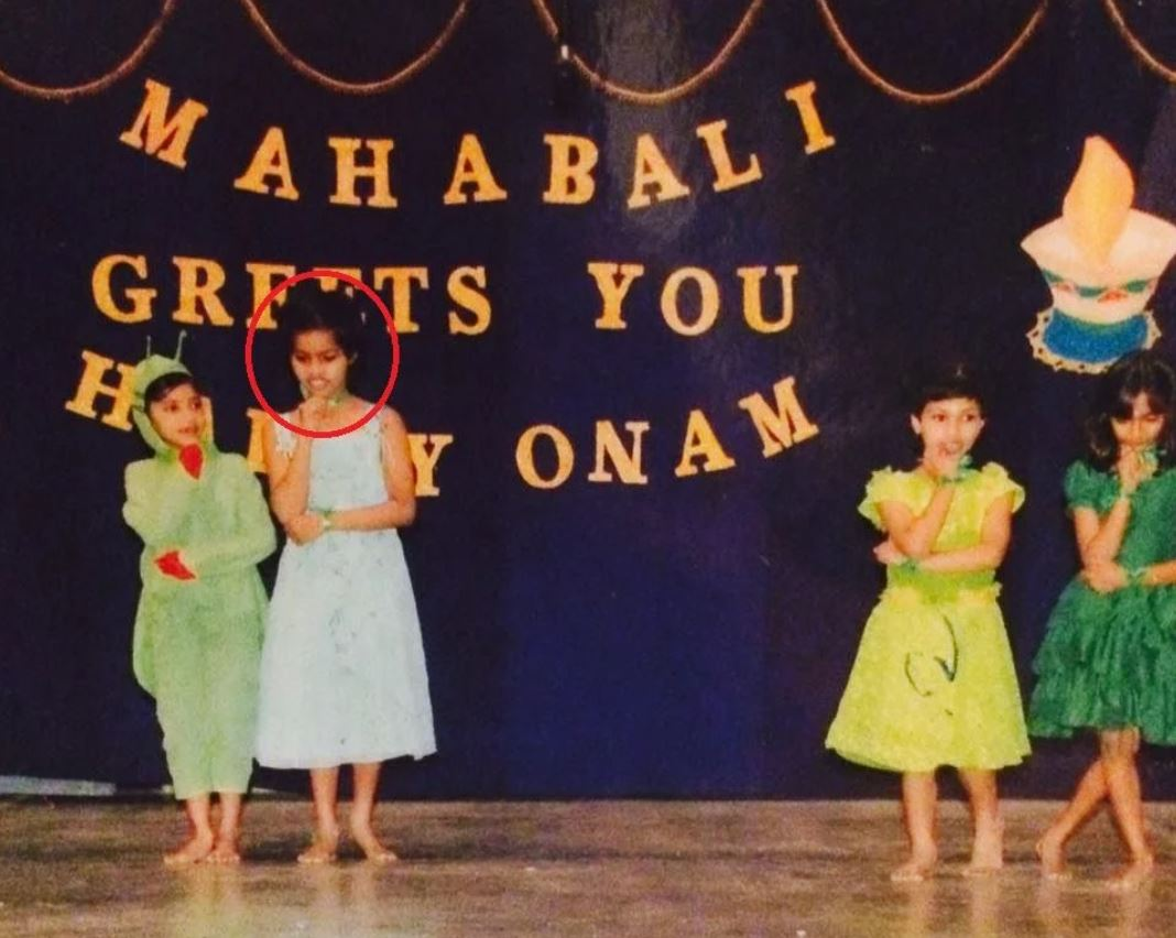 A picture of Preteen Michelle performing a dance act at a function held in her school on the occasion of Onam