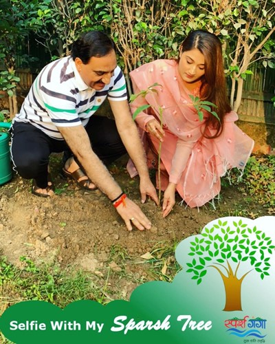 Arushi Nishank planting a tree with her father under the Sparsh Ganga campaign
