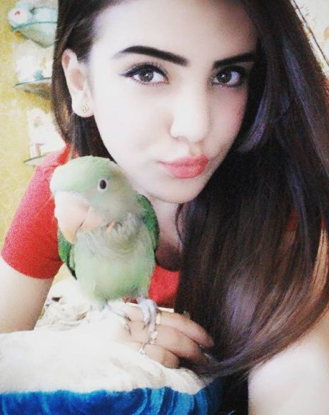 Azma Fallah with her parrot
