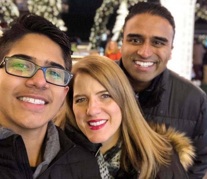 Maju Varghese with his wife and son