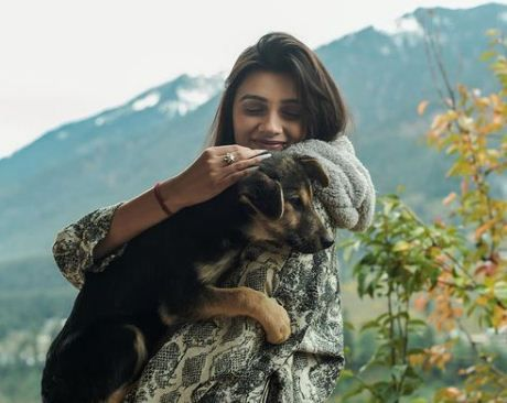 Pallak Yadav with a dog