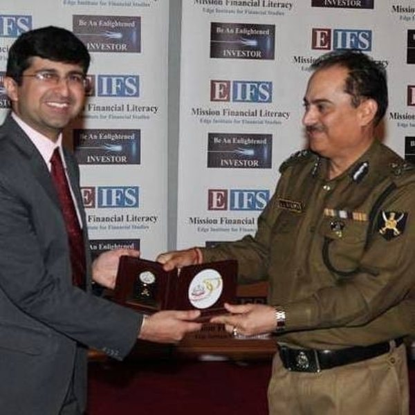 Varun Malhotra receiving a memento from a BSF officer for conducting training programs on financial literacy