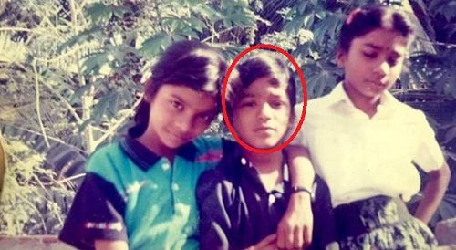 A childhood picture of Dhanush with his sisters