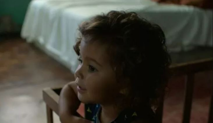 A still from the web series The Serpent showing a child as Usha