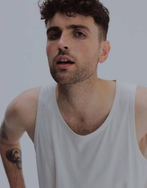 Duncan Laurence showing off his tattoos