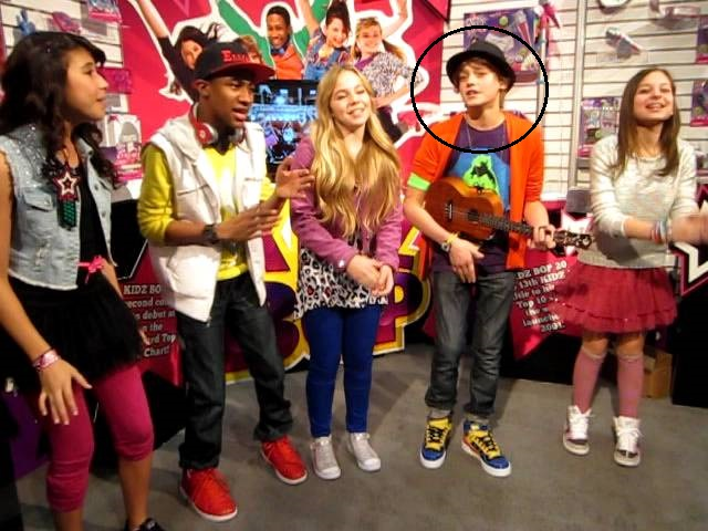Fin Argus, along with fellow Kidz Bop's members, performing at the International Toy Fair in New York (2012)
