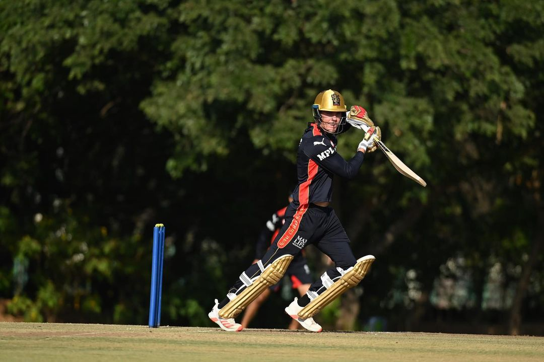 Finn Allen hits one during a practice session for RCB