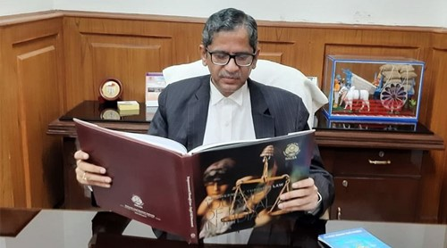 Justice N. V. Ramana reading a book