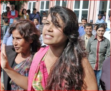 Nihita Biswas, along with her mother, walking out of the Supreme Court of Nepal after a court hearing in Sobhraj's case