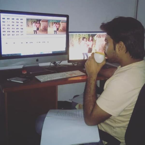 Ajay Sharma doing the editing work for a film