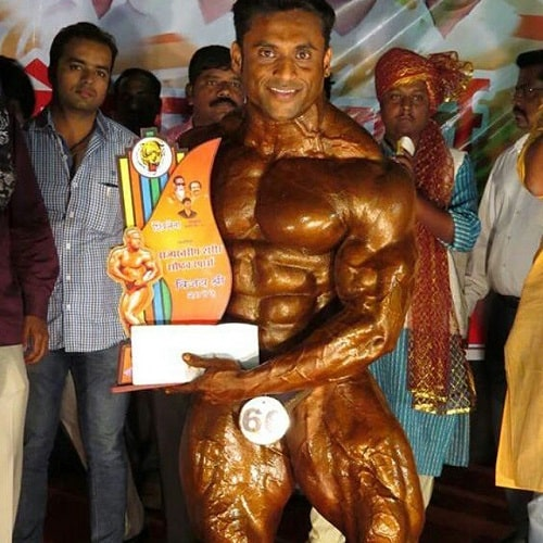Jagdish Lad with his trophy in a body building competition